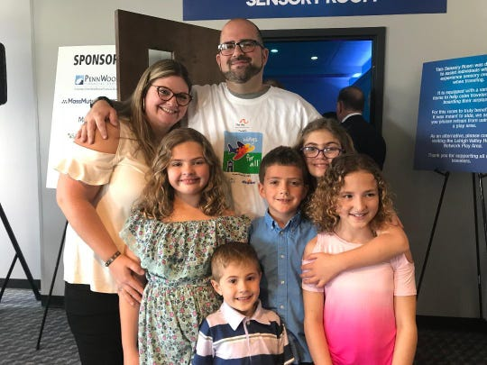 Joseph Mancini and his wife, Rachel Grimaldi, look forward to taking vacations with their four children, Matteo, 20; Lillian, 10; Julia, 9 and 8-year-old Benjamin. The family lives in ScotRun, Pa. Mancini has been instrumental in making Lehigh Valley International Airport more welcoming to those with sensory disorders.