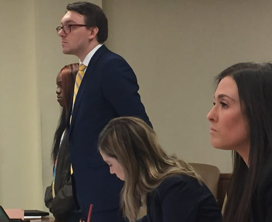 Quiasia Carroll of Gloucester City appears at a court hearing Friday with, left to right, Public Defender Eric Liszewski and assistant prosecutors Kaitlyn Compari and Lauren Pratter.