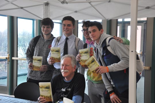 Mason High School students pose with author Jim Fox at book signing.