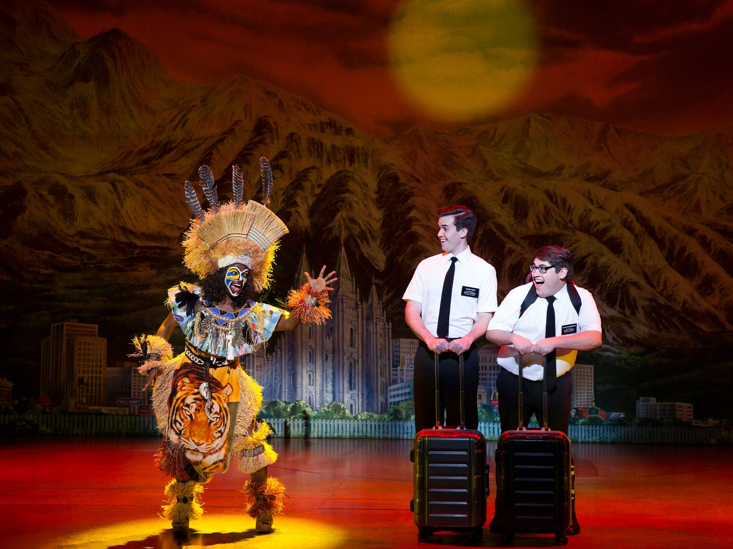 """Promising to be as cheeky as ever, """"The Book of Mormon"""" returns to the Aronoff Center August 4–9, 2020. Seen here are (from L) Monica L. Patton, Kevin Clay and Conner Peirson."""