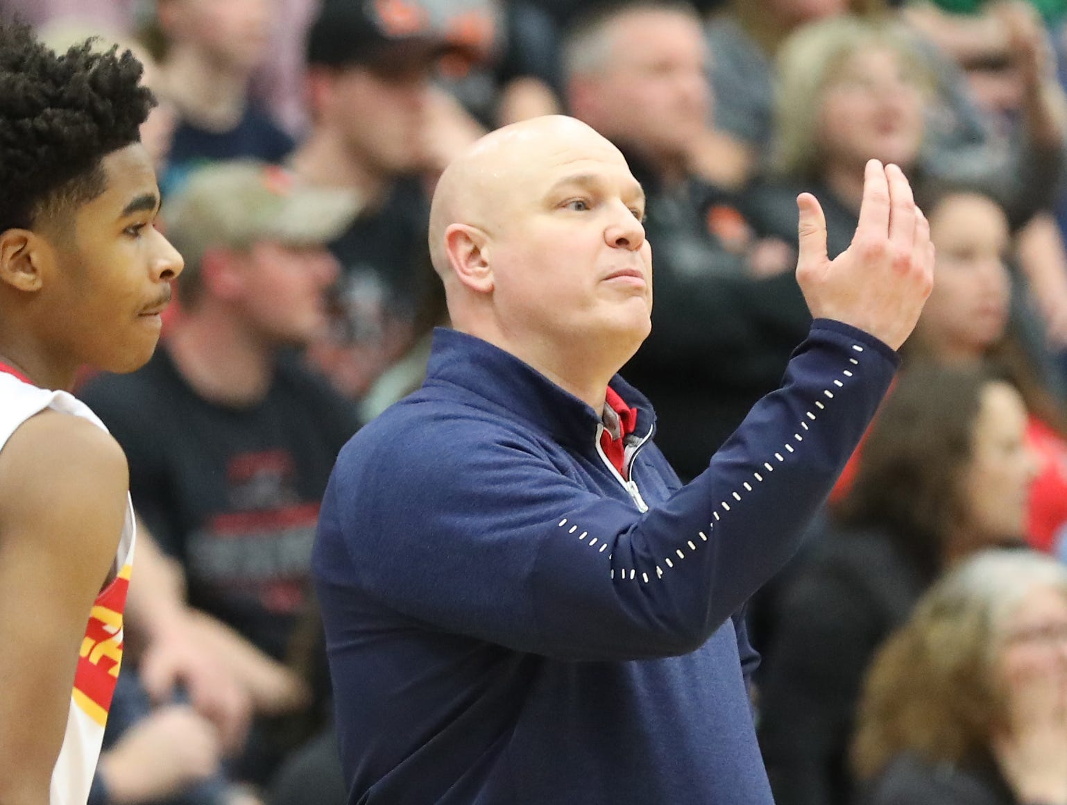 Purcell Marian head coach Scott Kerr reacts during the Cavaliers' regional semifinal win against Versailles Wednesday, March 13, 2019.