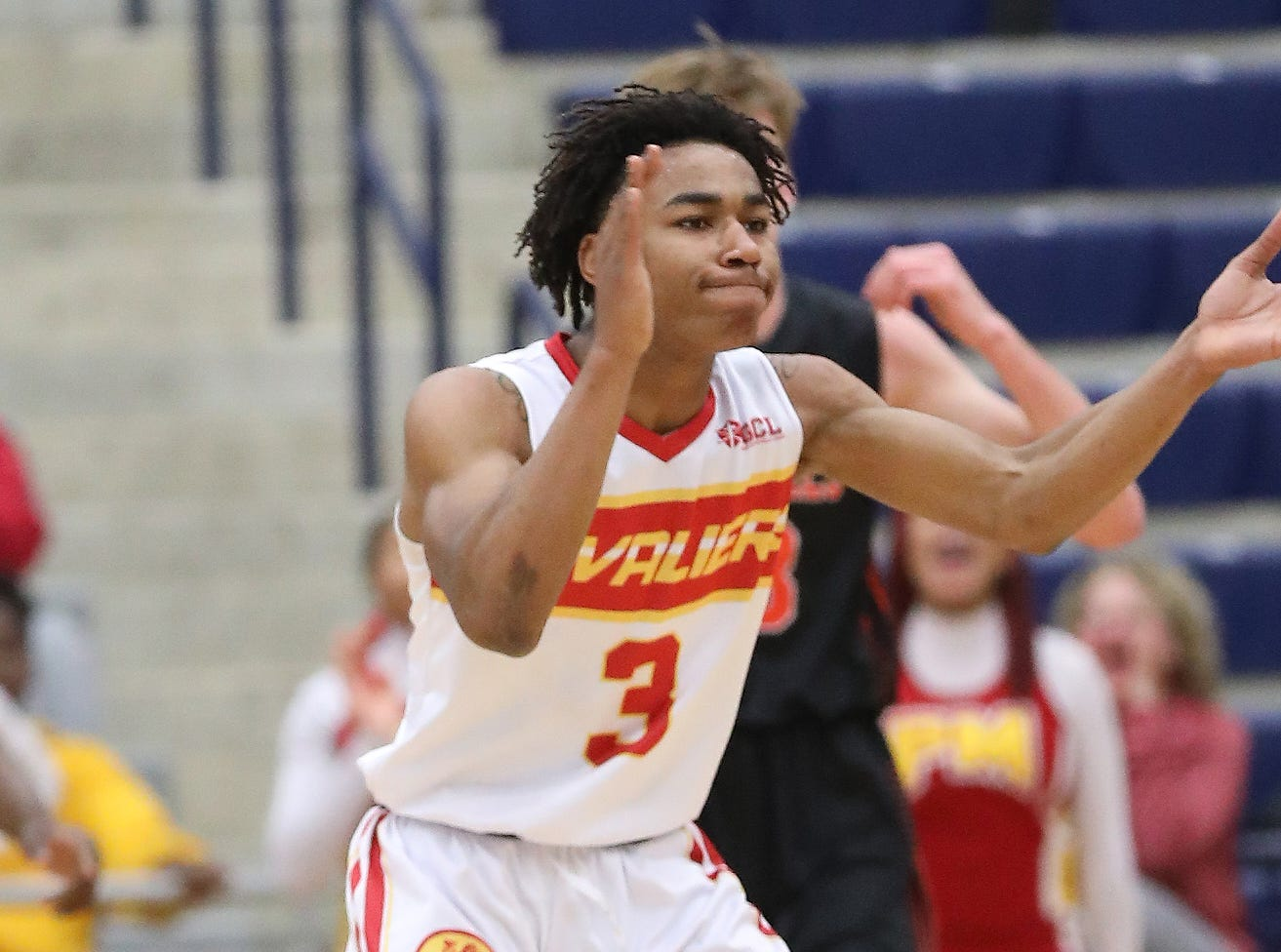 Purcell Marian guard Clarke Jefferson reacts during the Cavaliers' regional semifinal game against Versailles Wednesday, March 13, 2019.
