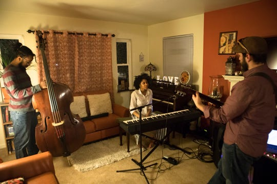 """Adanya Stephens, 16, center,  rehearses with Terrell Montgomery, left, and Nick Rose, right, on Tuesday, March 12, 2019, in Cincinnati, for a concert she is performing with members of her band Quiet Sounds of Qualia at her album release part Thursday.  The album she is releasing is entitled """"Naïve Nostalgia."""""""