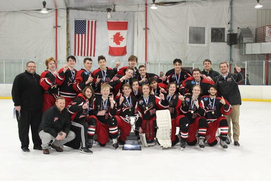 Students from the Norse High School varsity hockey team celebrate after being named 2019 state champions.