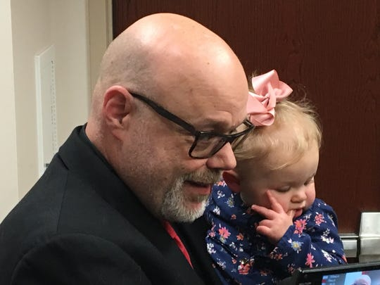 Dan Mockbee holds his five-month-old great-niece Ellie as he talks about his murdered wife Michelle Mockbee after Wednesday's guilty jury verdict in the David Dooley murder trial at Boone County's courthouse.