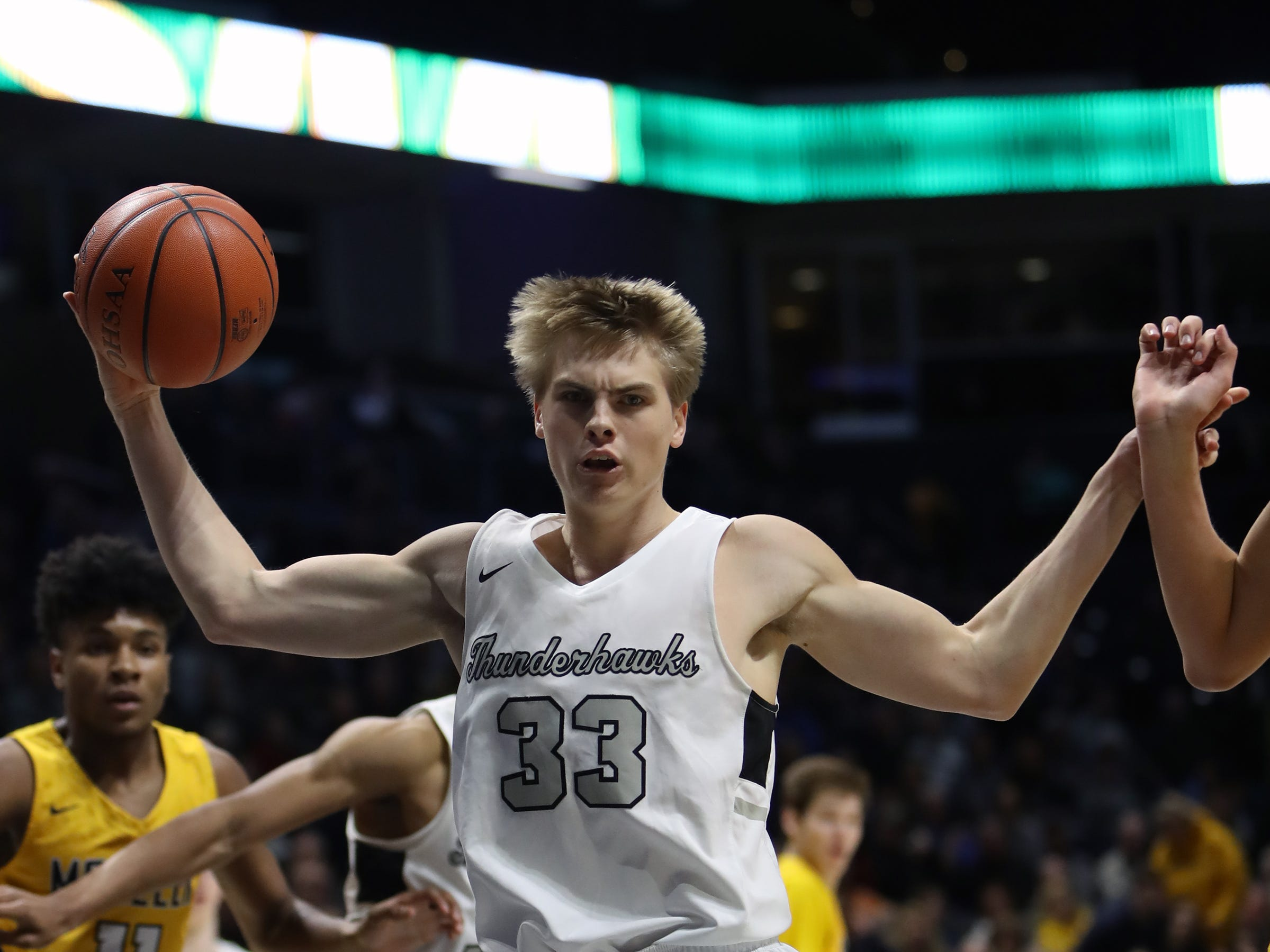 Lakota East center Grant Spicer grabs a defensive rebound in the first half in the boys regional semifinal at the Cintas Center at Xavier University.