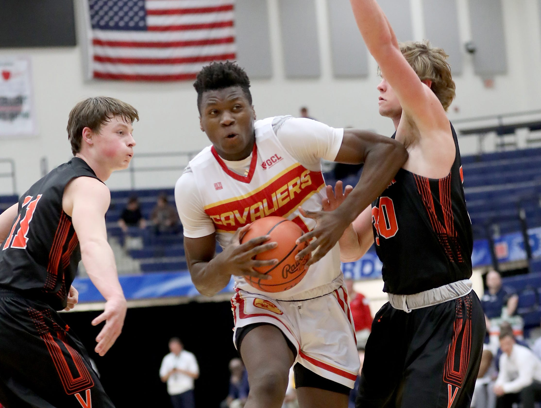 Purcell Marian forward Bryan Warah drives to the basket during the Cavaliers' regional semifinal against Versailles Wednesday, March 13,2019.