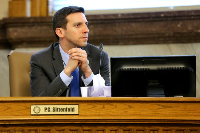 Cincinnati City Councilmember P.G. Sittenfeld listens to proceedings, Wednesday, March 13, 2019, in council chambers at Cincinnati City Hall.