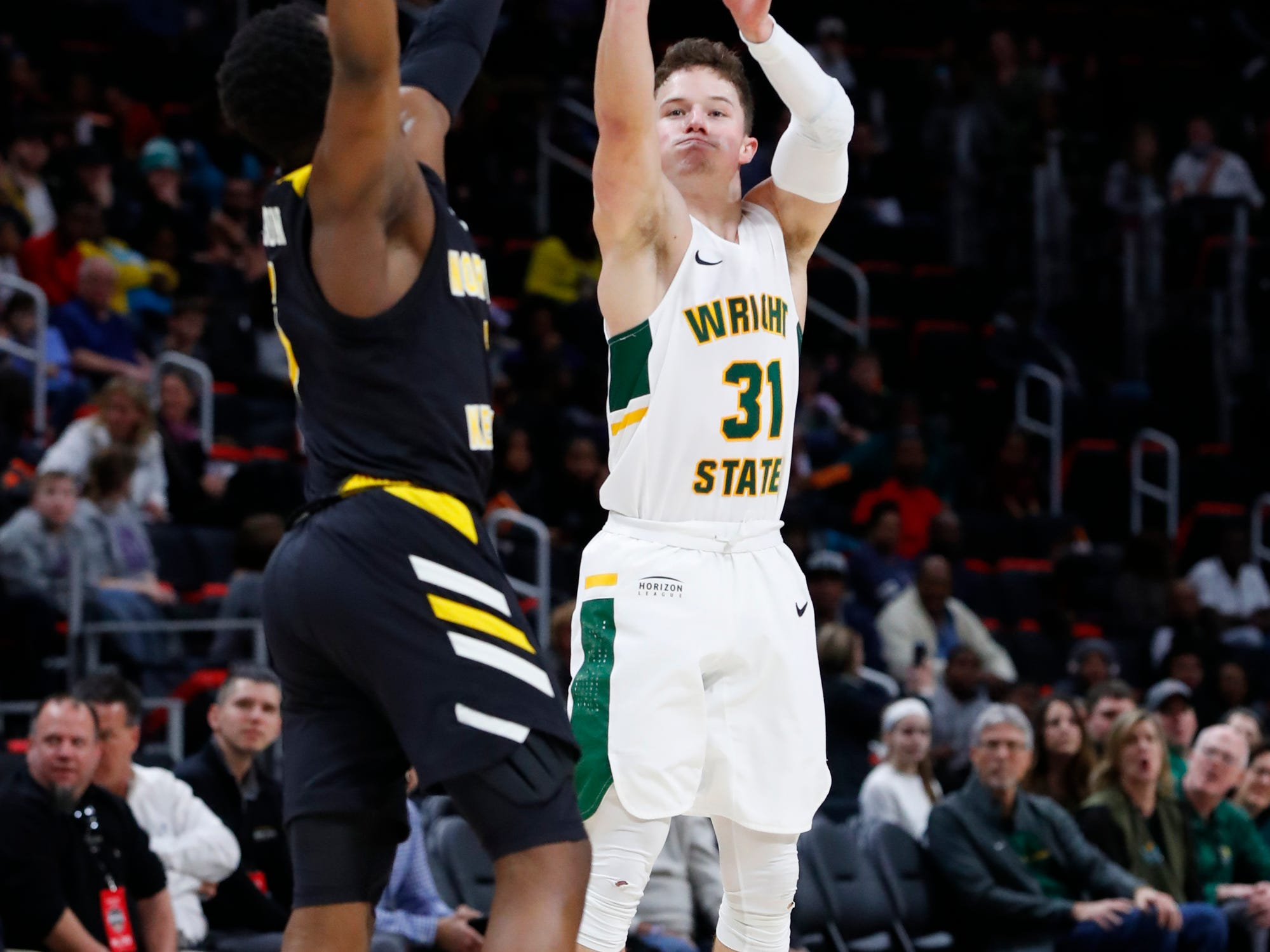Wright State guard Cole Gentry (31) shoots against Northern Kentucky in the first half of an NCAA men's basketball game in the Horizon League conference tournament championship in Detroit, Tuesday, March 12, 2019.