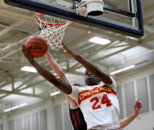 Purcell Marian forward Bryan Warah drives to the basket during the Cavaliers' regional semifinal  game against Versailles Wednesday, March 13, 2019.