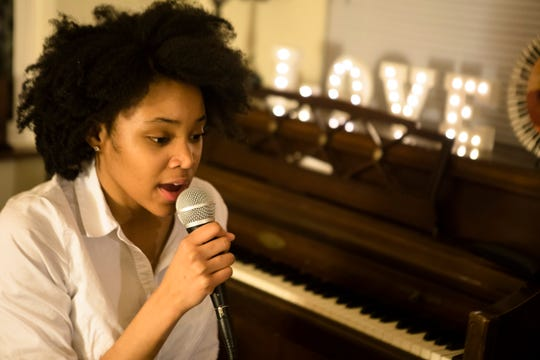 """Adanya Stephens, who will turn 17 on Thursday, March 14, rehearses on Tuesday in her mother's Bond Hill apartment for a concert she is performing with members of her band, Quiet Sounds of Qualia, at her album release part Thursday at Elementz in Over-the-Rhine. Her album is titled """"Naïve Nostalgia."""""""