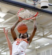 Purcell Marian foward A.J. Garrett dunks during the Cavaliers' regional semifinal against Versailles Wednesday, March 13, 2019.
