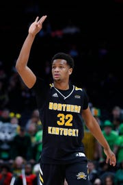 Northern Kentucky forward Dantez Walton (32) celebrates a 3-point shot against Wright State during the second half of an NCAA college basketball game for the Horizon League men's tournament championship in Detroit, Tuesday, March 12, 2019.