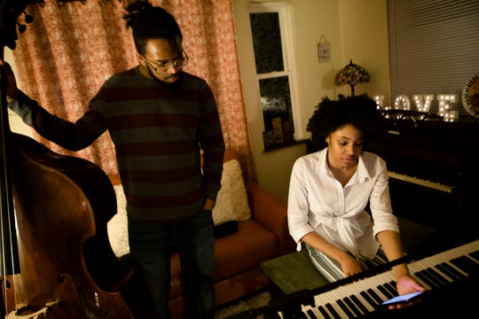 "Adanya Stephens, 16, goes over music with Terrell Montgomery on Tuesday, March 12, 2019, in Cincinnati for a concert she is performing with members of her band Quiet Sounds of Qualia at her album release part Thursday.  The album she is releasing is entitled ""Naïve Nostalgia."""