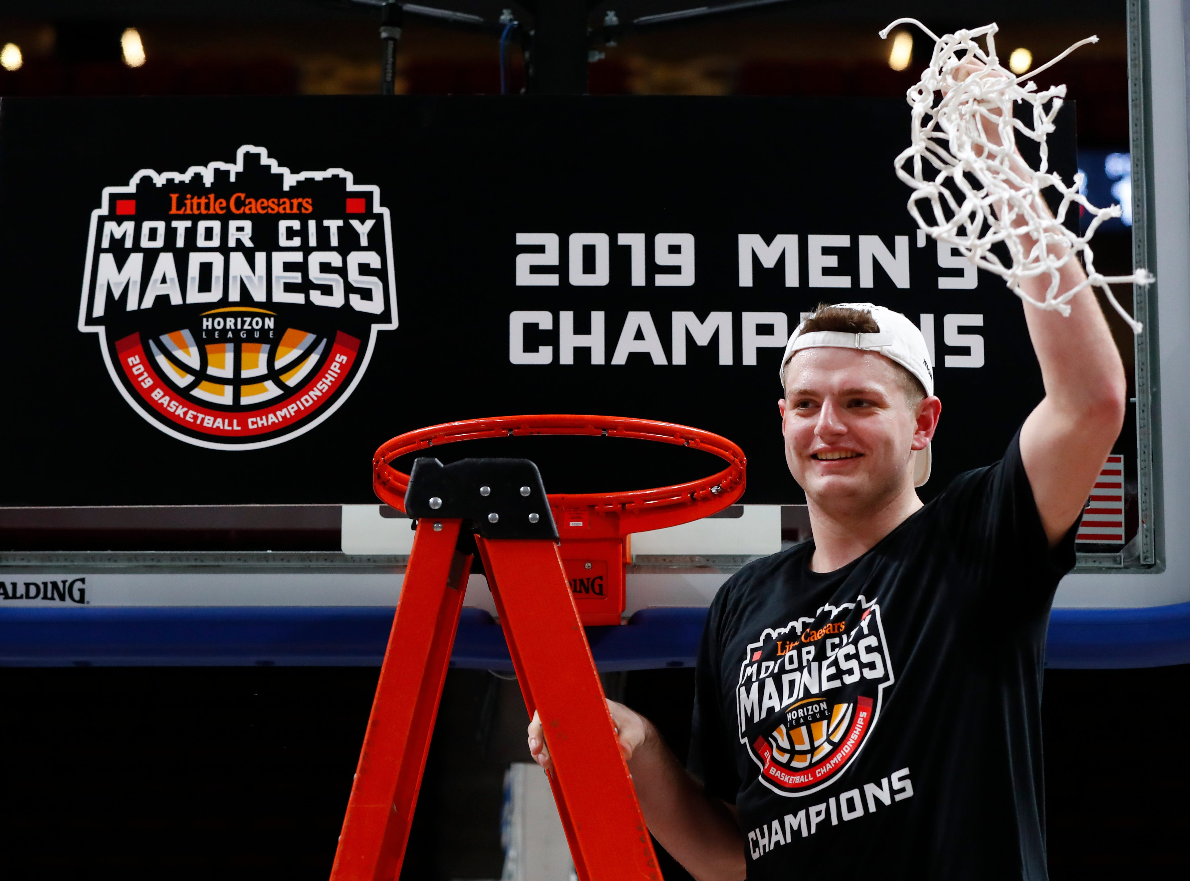 Northern Kentucky's Drew McDonald holds up the net after the team's 77-66 win against Wright State in an NCAA college basketball game for the Horizon League men's tournament championship in Detroit, Tuesday, March 12, 2019.
