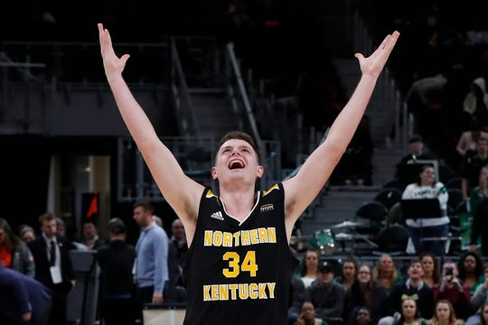 Northern Kentucky forward Drew McDonald celebrates the team's 77-66 win against Wright State during an NCAA college basketball game for the Horizon League men's tournament championship in Detroit, Tuesday, March 12, 2019.