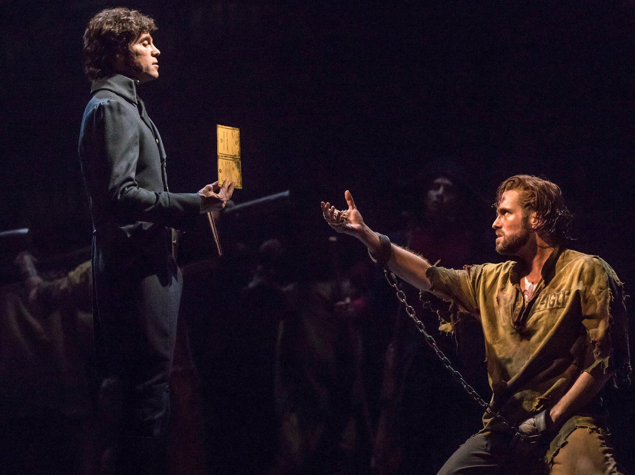 """(From L) Josh Davis as Inspector Javert and Nick Cartell as Jean Valjean in the national tour of """"Les Misérables."""" The show will play the Aronoff Center Feb. 11-23, 2020 as part of the Broadway in Cincinnati series."""