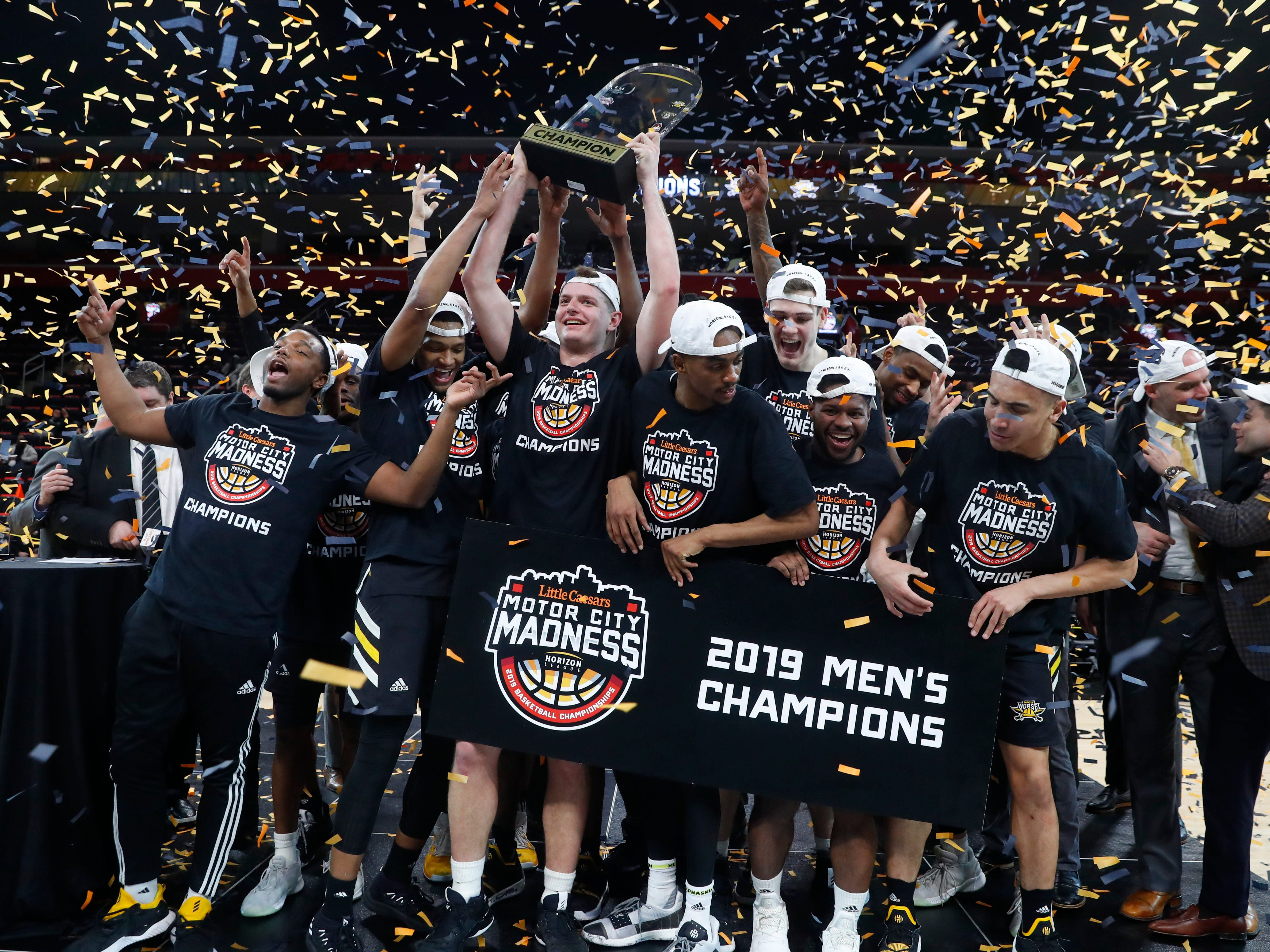 Northern Kentucky players celebrate their 77-66 win against Wright State after an NCAA college basketball game for the Horizon League men's tournament championship in Detroit, Tuesday, March 12, 2019.