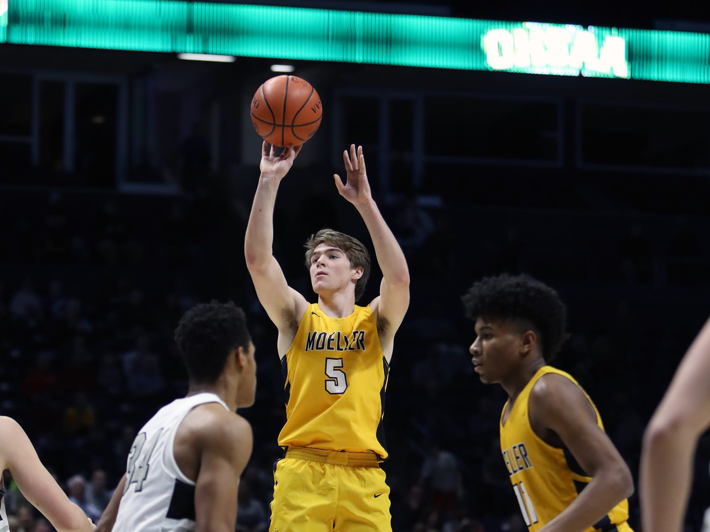 Moeller guard Alec Pfriem attempts a jump shot in the first half in the boys regional semifinal at the Cintas Center at Xavier University.
