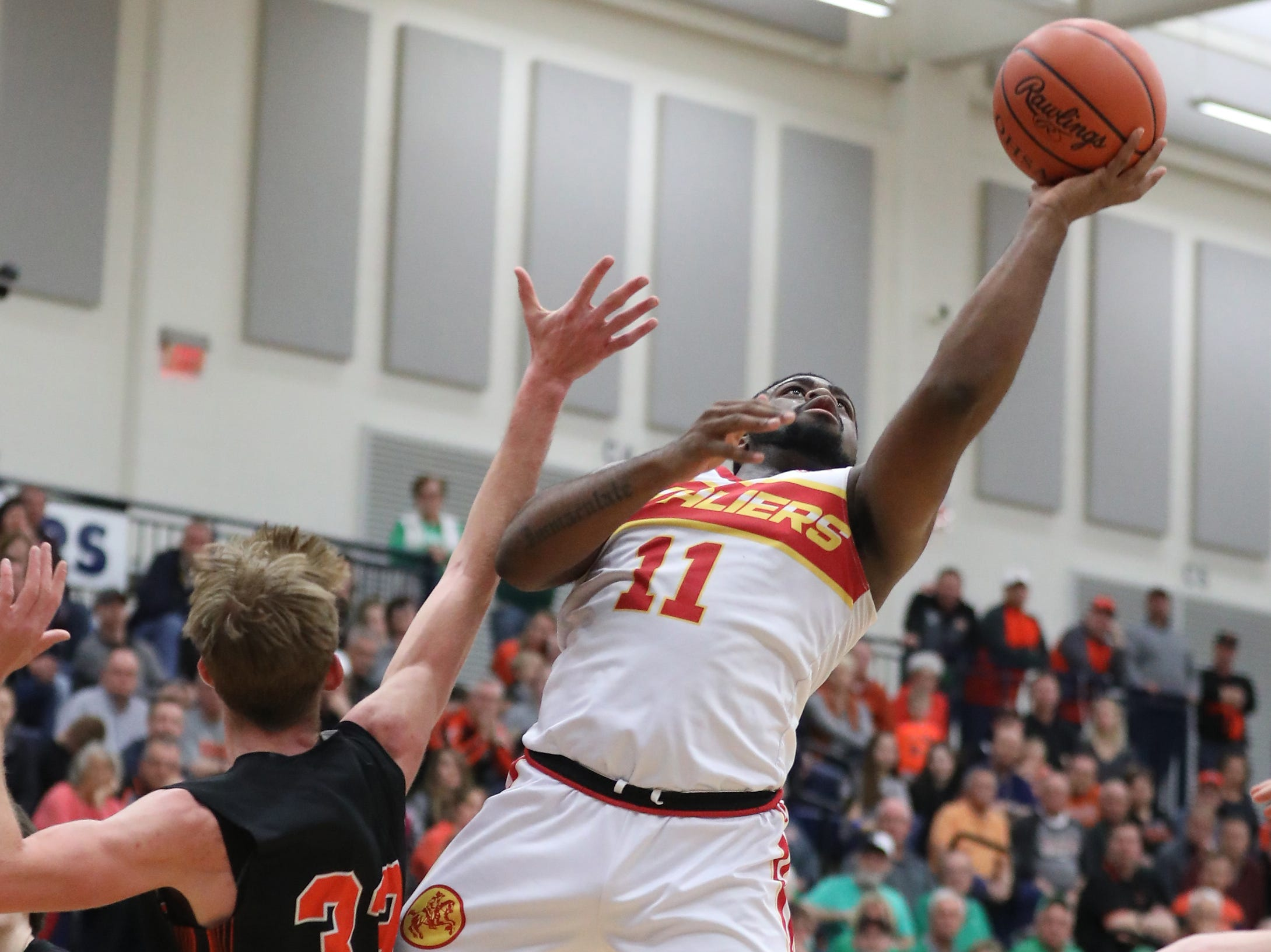 Purcell Marian forward Javonta Lyons scores two of his team high  16  points  during the Cavaliers' regional semifinal win against Versailles Wednesday, March 13, 2019.