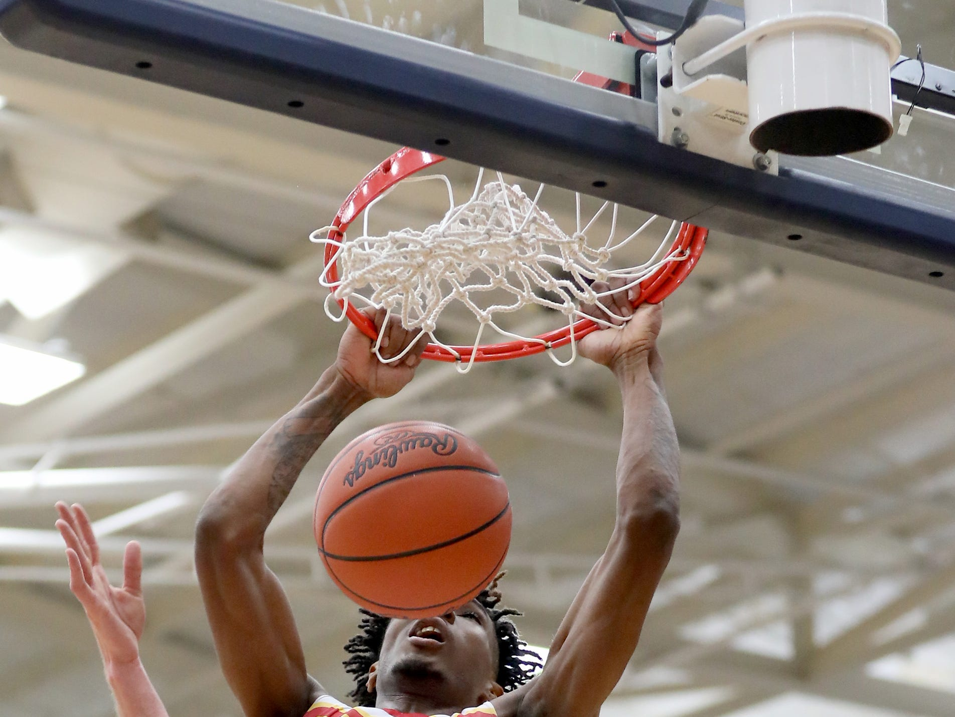 Purcell Marian forward A.J. Garrett dunks during the Cavaliers' regional semifinal game against Versailles Wednesday, March 13, 2019.