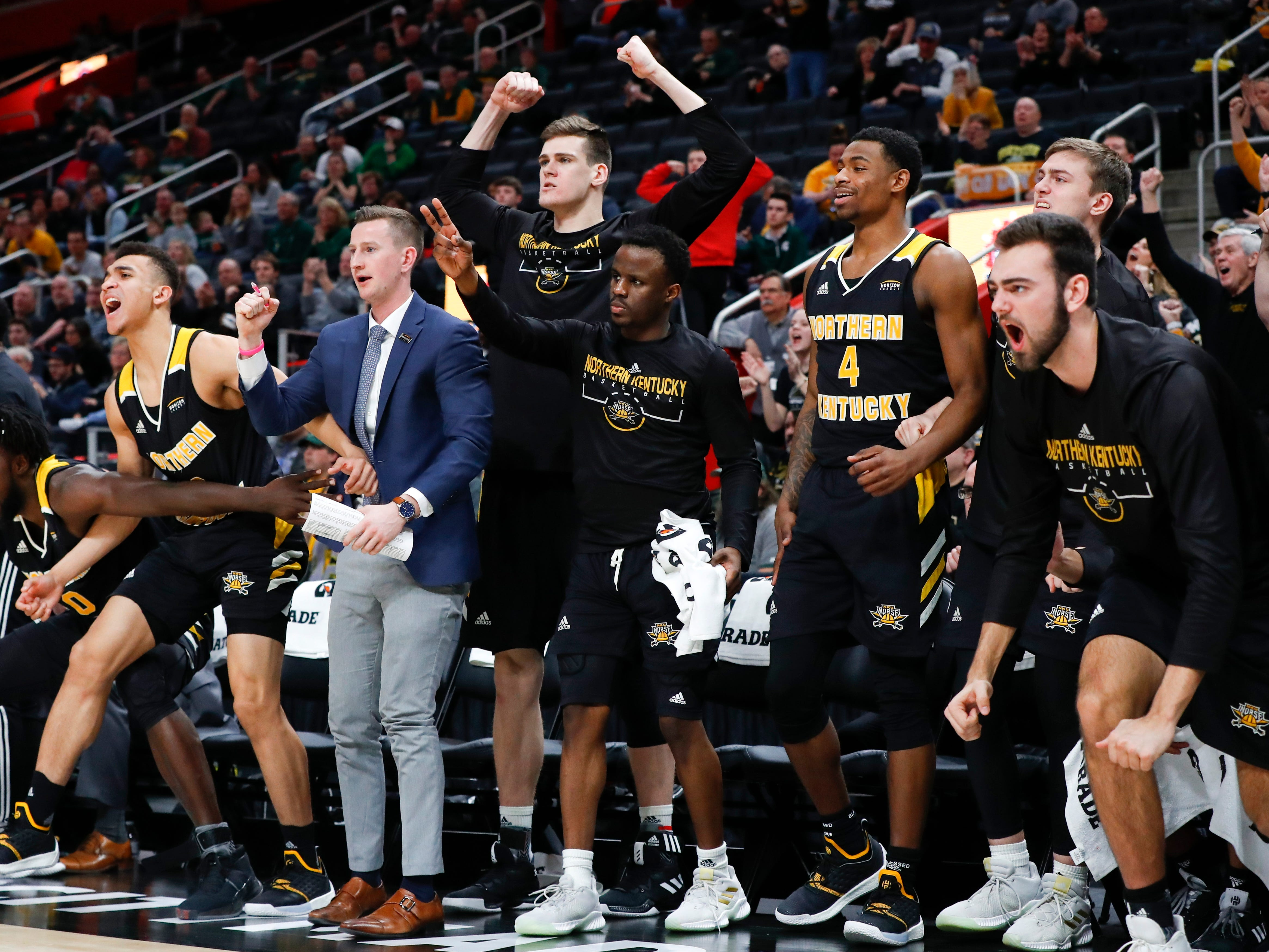 Northern Kentucky players celebrate a basket against Wright State during the second half of an NCAA college basketball game for the Horizon League men's tournament championship in Detroit, Tuesday, March 12, 2019.
