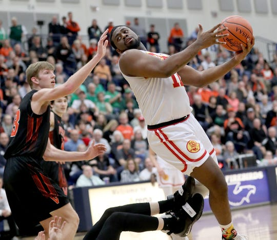 Purcell Marian guard Javonta Lyons drives to the basket during the Cavaliers' regional semifinal win over Versailles Wednesday, March 13, 2019.