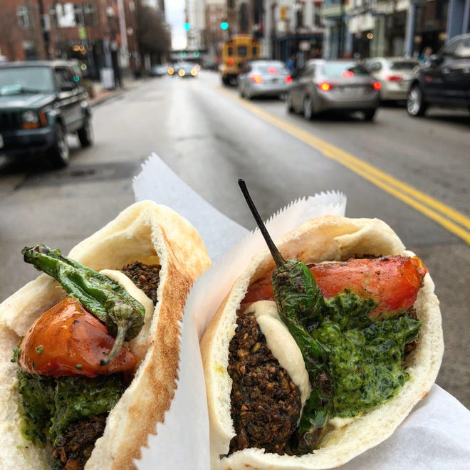 Sandwiches from Forty Thieves , the shawarma bar at Holiday Spirits Bar on Liberty Street in OTR