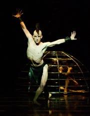"Cincinnati Ballet principal dancer Cervilio Miguel Amador is seen as the evil Koschei in the company's 2011 presentation of Adam Hougland's production of ""The Firebird."""