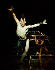 "Cincinnati Ballet principal dancer Cervilio Miguel Amador is seen as the evil Koschei in the company's 2011 presentation of Adam Hougland's production of ""The Firebird."""