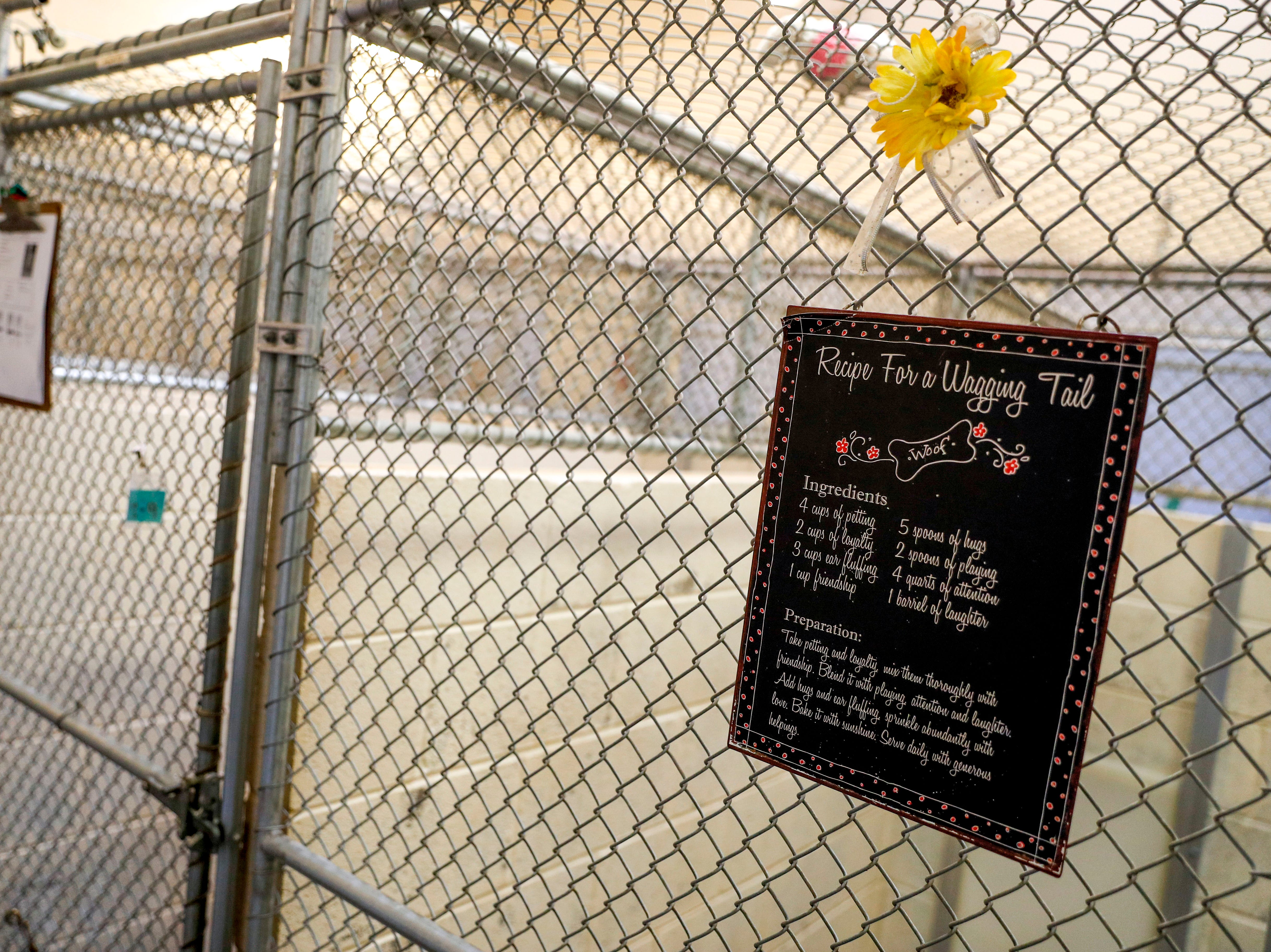 A sign reminds visitors of tips and instructions about how to keep dogs happy and care for them during visits at Montgomery County Animal Care and Control in Clarksville, Tenn., on Wednesday, March 13, 2019.