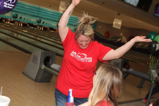 Kendra Coveney of US Bank celebrates with co-worker Kylie Showalter at the Big Brothers Big Sisters 2019 Bankers Challenge at the Pinnacle Family Entertainment Center on Tuesday, March 12, 2019.