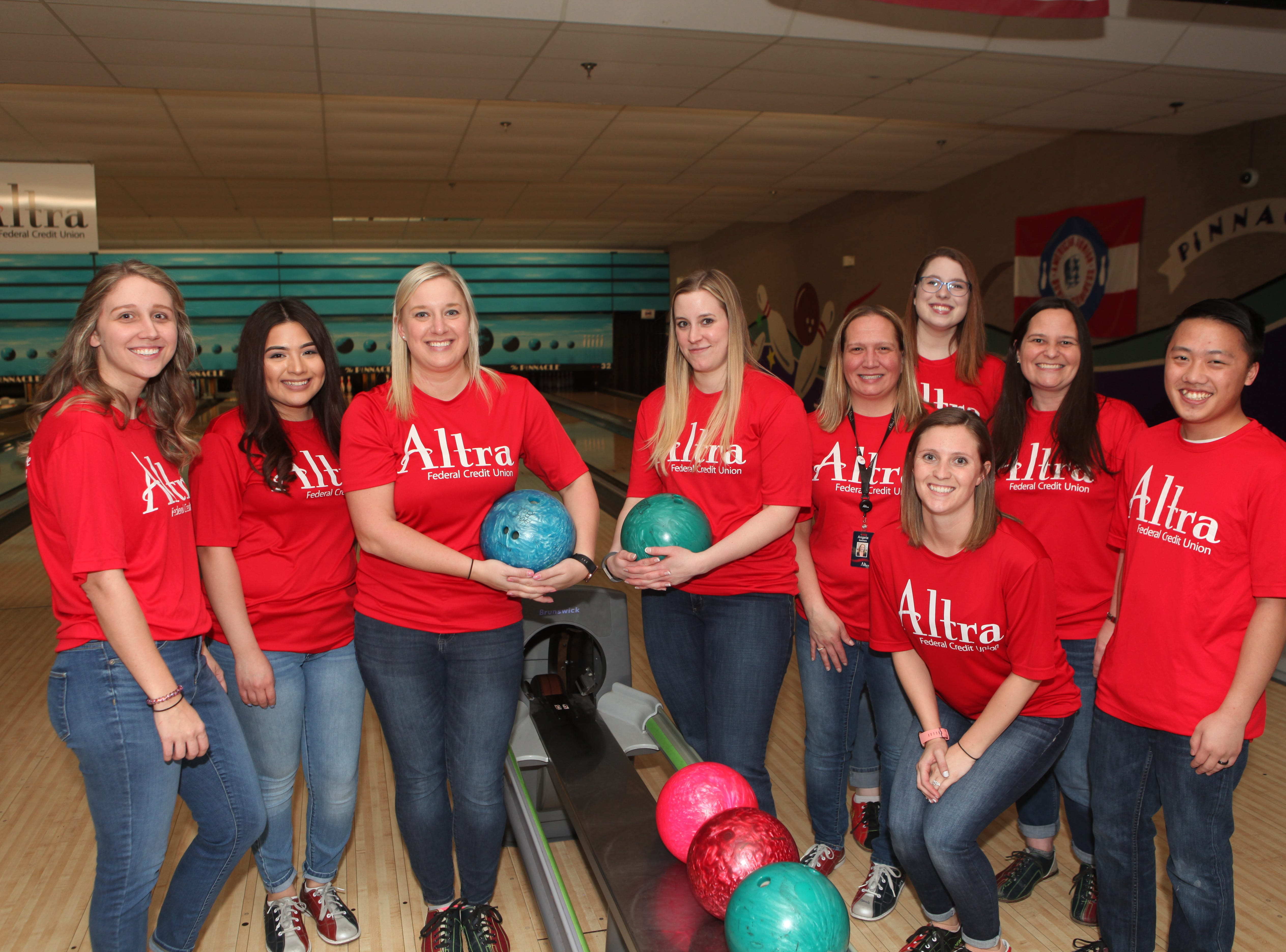 Altra Federal Credit Union team members at the Big Brothers Big Sisters 2019 Bankers Challenge at the Pinnacle Family Entertainment Center on Tuesday, March 12, 2019.