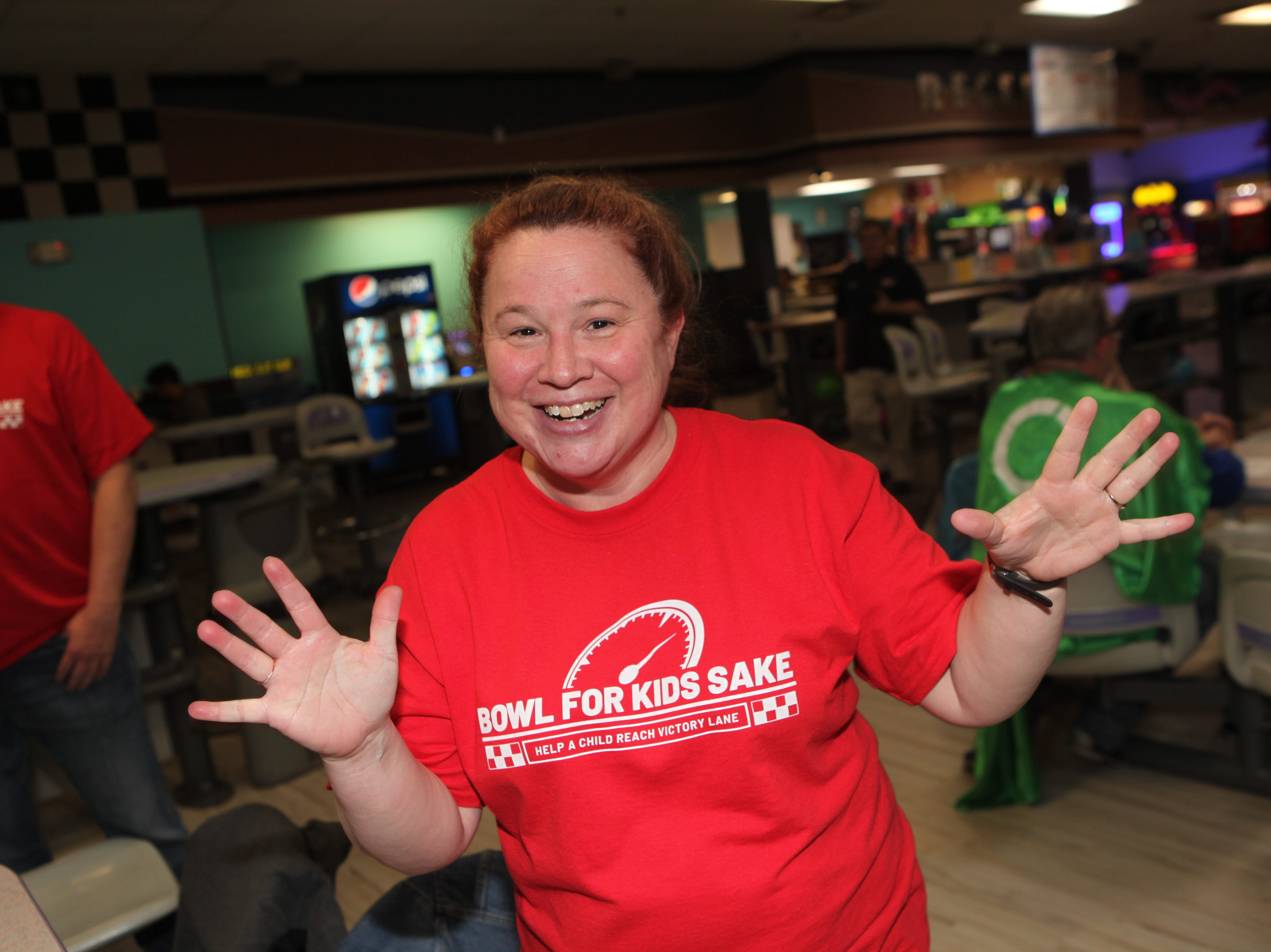 Brandy Jones after a strike at the Big Brothers Big Sisters 2019 Bankers Challenge at the Pinnacle Family Entertainment Center on Tuesday, March 12, 2019.