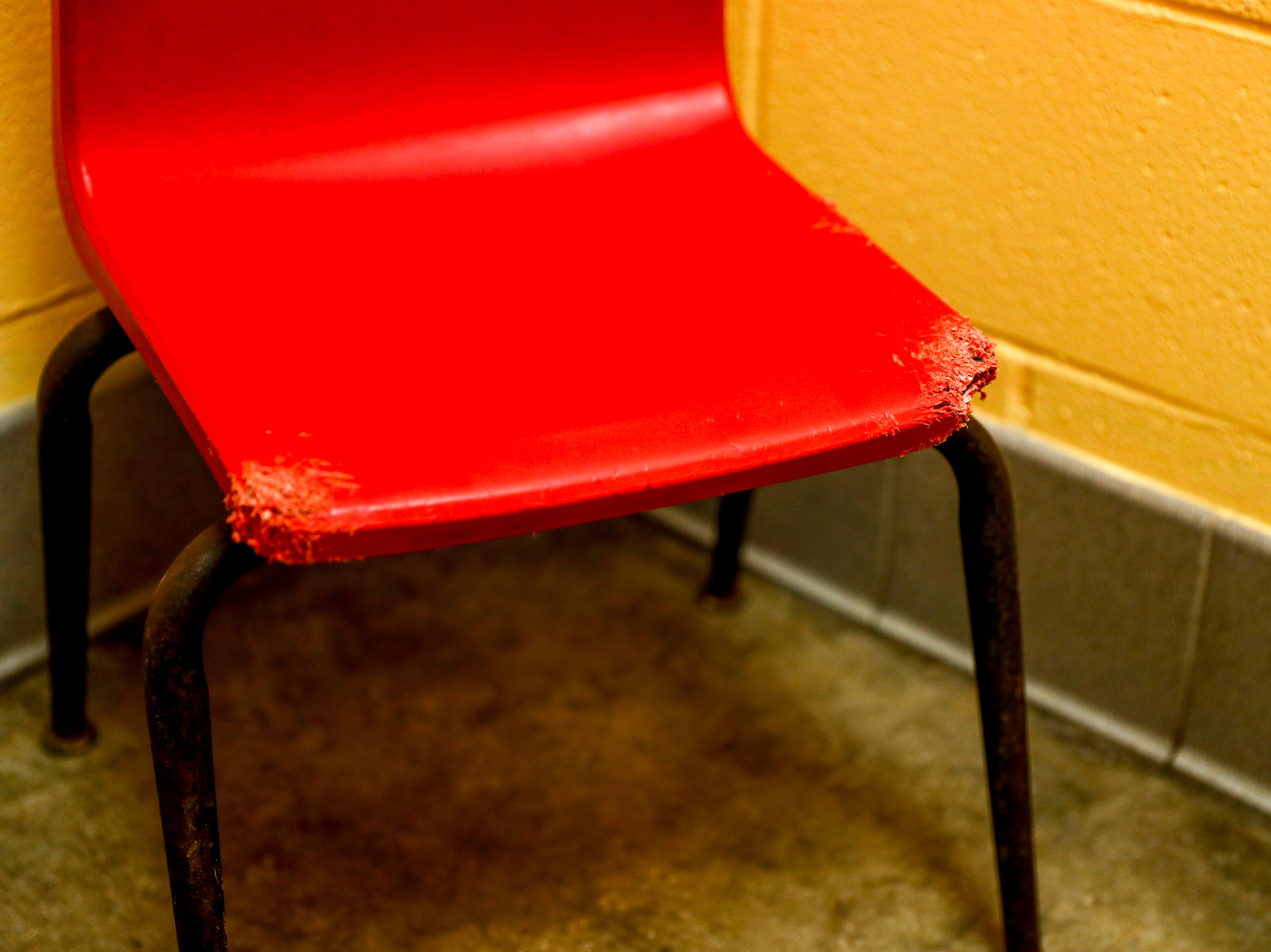 In the visiting or examination room, a small chair for visitors sits with chew marks in the corner at Montgomery County Animal Care and Control in Clarksville, Tenn., on Wednesday, March 13, 2019.
