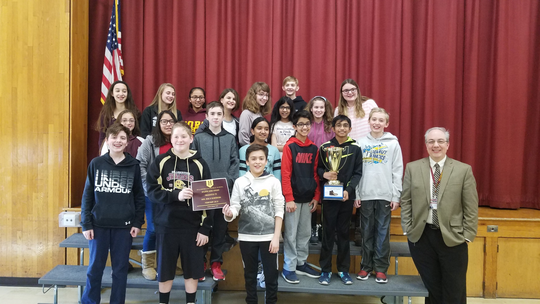 """Pictured are students in Lisa Kiel's homeroom along with Principal, Dr. Joe Trybulski. This homeroom won the """"The Golden Shoe Award"""" and collected 168 pairs of shoes for donation."""