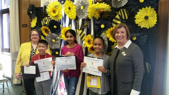 Left to right:  Brandi-Leigh Miller, NJSFWC Spelling Bee Chairman; Douglas Gee, first place; Sanjana Sri Veggalam, second place; Ysabel Godet, third place and Mary  Wolfe, president, New Jersey State Federation of Women's Clubs of GFWC