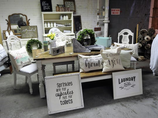 Rust Decor sells vintage clothing, reclaimed and salvaged pieces and a variety of items from 12 different local vendors at its new 5,000 foot space at 1148 Walnut St.