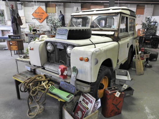 A 1965 Land Rover is a centerpiece of Rust Decor for children to play on and in as their parents shop through the store.