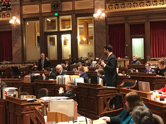 Sen. Julian Garrett, R-Indianola (left) and Sen. Zach Wahls, D-Coralville, debate adding pro-gun language to the Iowa Constitution on Wednesday, March 13, 2019. The resolution passed the Iowa Senate 33-16.