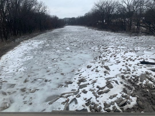 A look at the ice-jammed, frozen Raccoon River near H Avenue in Redfield in Dallas County on Wednesday, March 13, 2019.