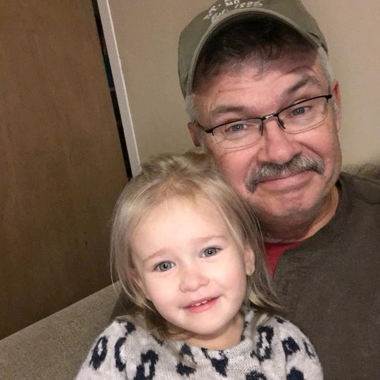 Tim Johnson and his granddaughter Lily.