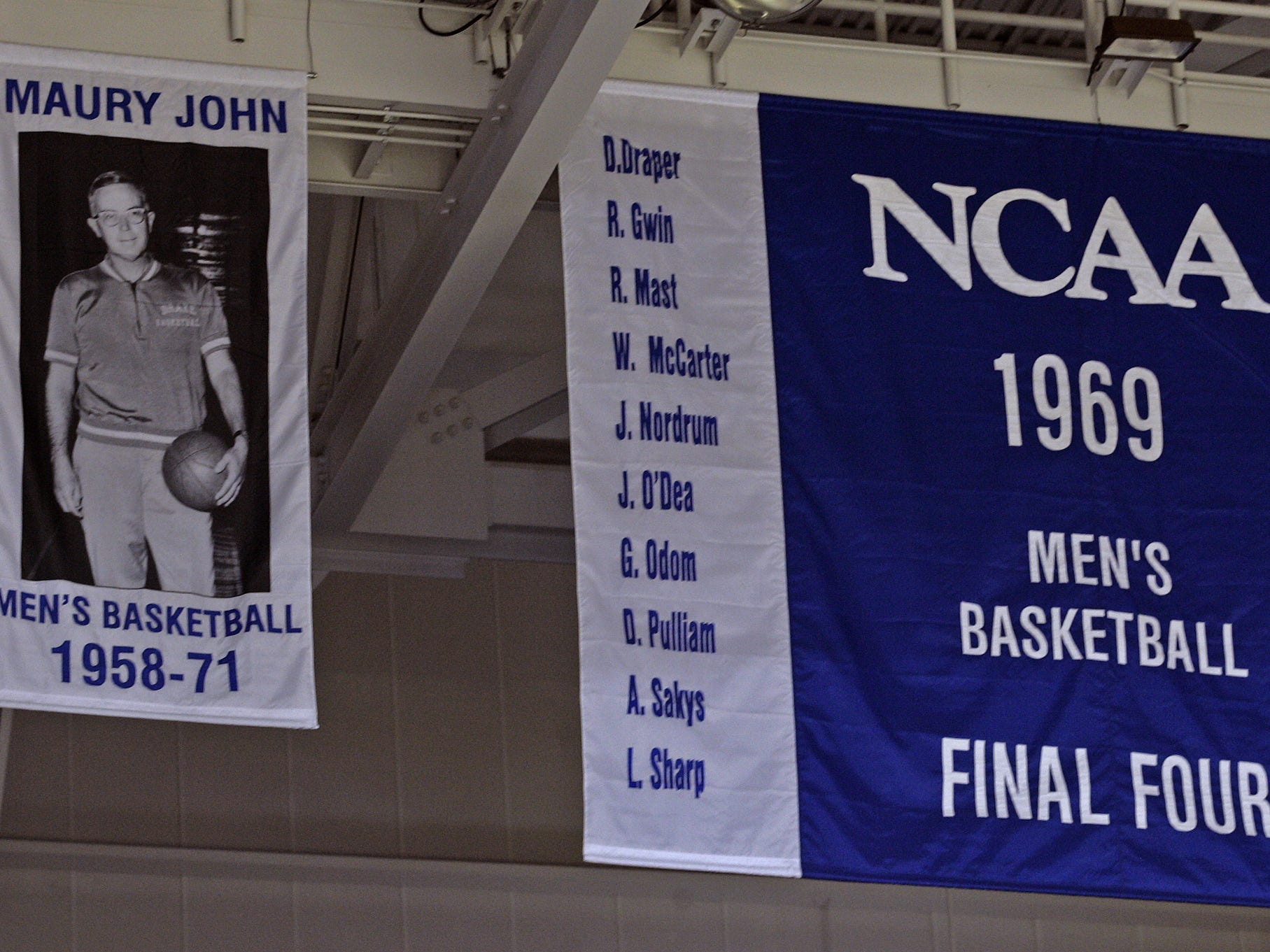 From 2008: Banners recognizing longtime Drake men's basketball coach Maury John and the school's 1969 Final Four team are unveiled during a 2008 ceremony recognizing that NCAA Tournament run by the Bulldogs.