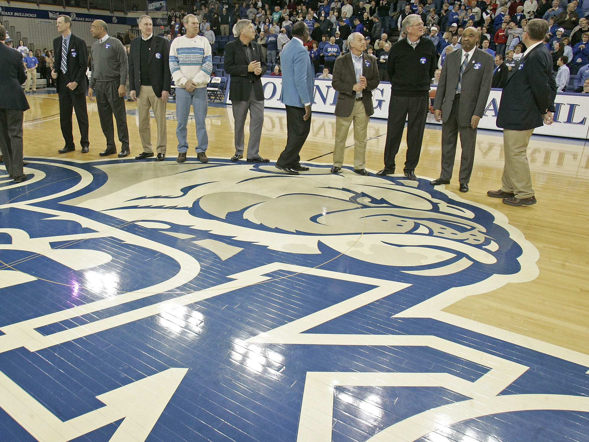 From 2008: Members of the 1969 Drake Final Four team gather at half court during a ceremony celebrating their famous run in the NCAA Tournament. Banners recognizing the team and late coach Maury John were unveiled during the festivities.
