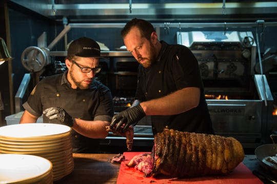 Benjamin Zemach of Detroit and Executive Chef Ryan Prentiss prepare prime rib at Prime + Proper, one of the restaurants featured in a new charity event.