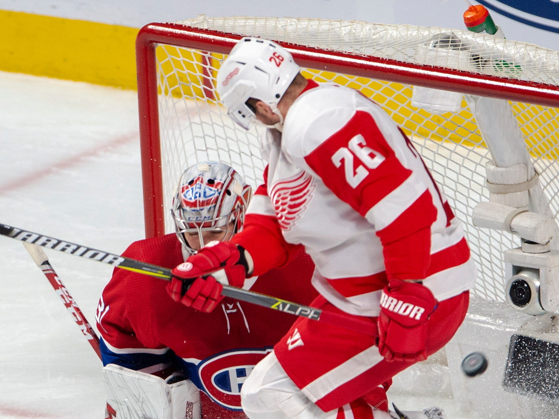 Detroit Red Wings left wing Thomas Vanek jumps in front of Montreal Canadiens goaltender Carey Price during the first period Tuesday, March 12, 2019, in Montreal.