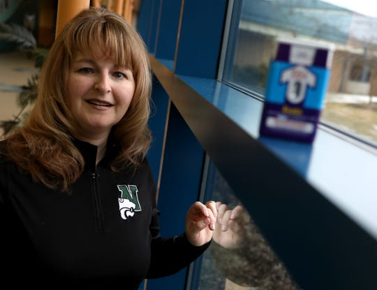 Cathy Farris, a registered nurse with the Novi Community School District, poses with Narcan at Novi Middle School in Novi on Wednesday, March 13, 2019. Farris was instrumental in getting Narcan available at the school in the event of an opioid overdose.