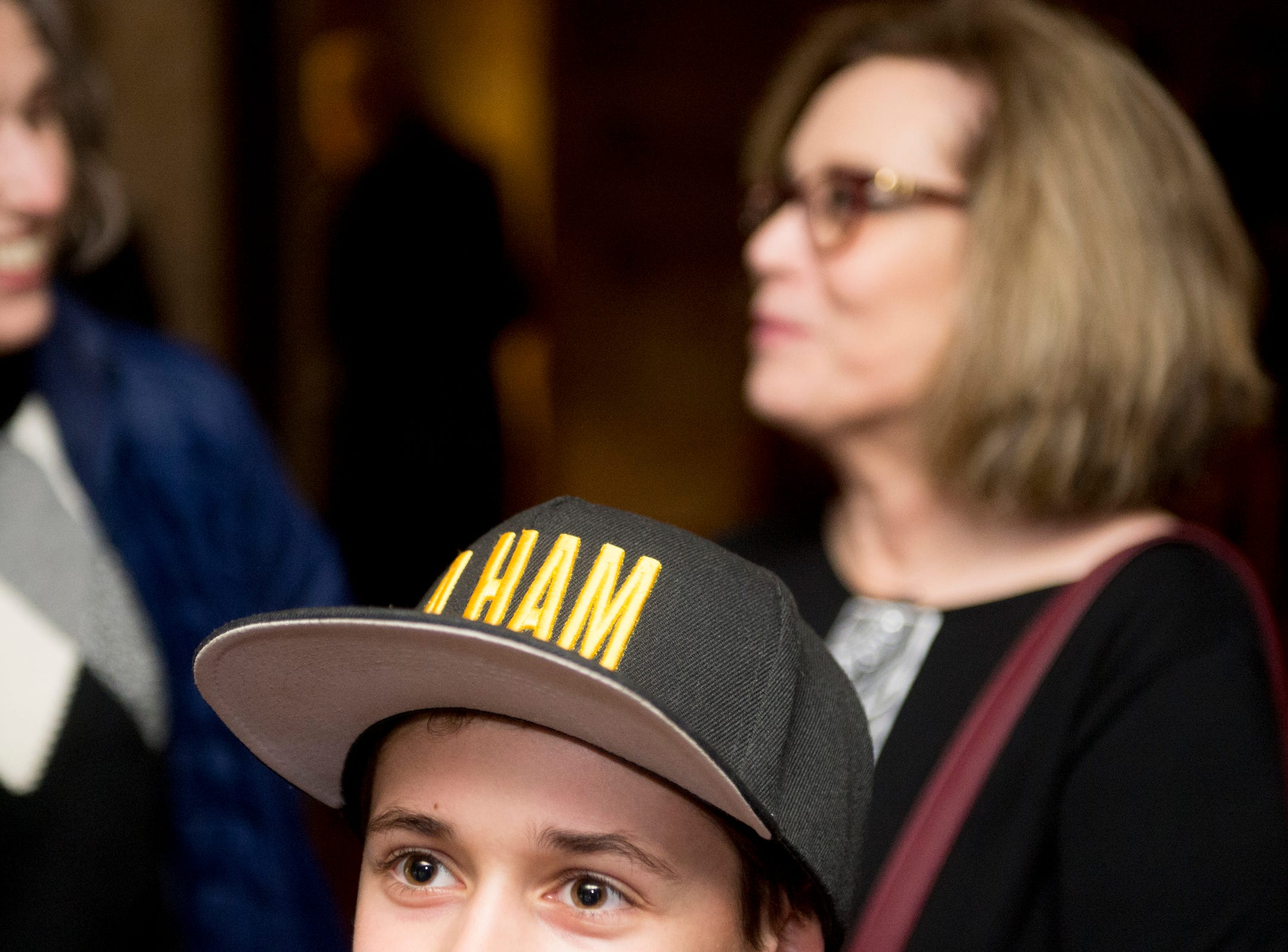"""Adam Michaels, 12, of Farmington Hills wears a hat that says """"A Ham"""" while waiting for the doors for Hamilton to open at the Fisher Theatre in Detroit on Tuesday, March 12, 2019. The opening night of Broadway's Hamilton played to a full house in Detroit on Tuesday."""