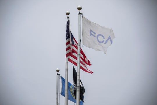 Tattered flags fly outside of Fiat Chrysler's Mt. Elliott Tool and Die plant in Detroit on Wednesday.