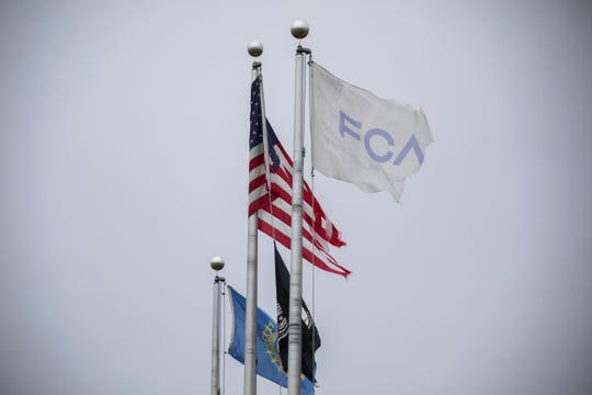 Tattered flags fly outside of Fiat Chrysler's Mt. Elliott Tool and Die plant in Detroit on Wednesday.